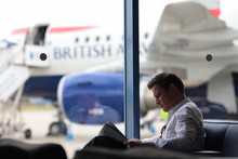 A customer in the JFK lounge at London City Airport