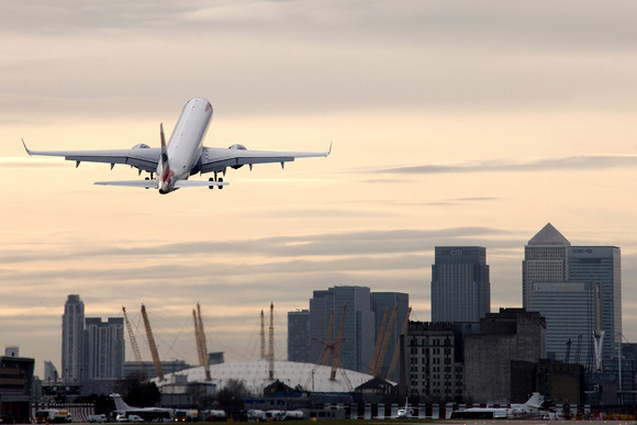 An Embraer 190 takes off from London City over Canary Wharf